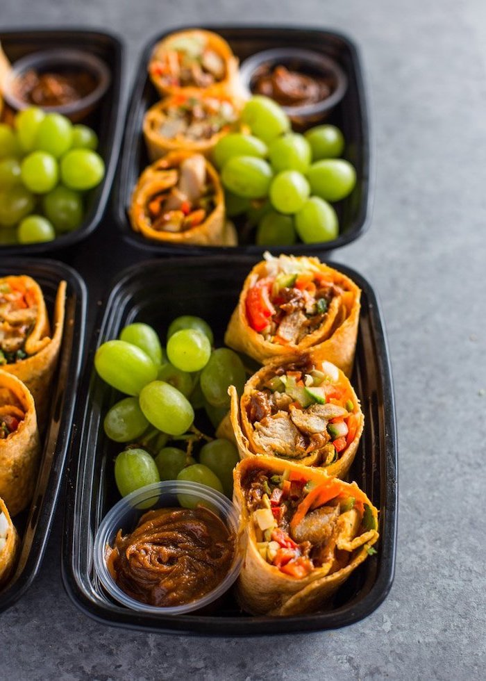 mini burritos, grapes and barbecue sauce, inside a black plastic container, easy meal prep ideas