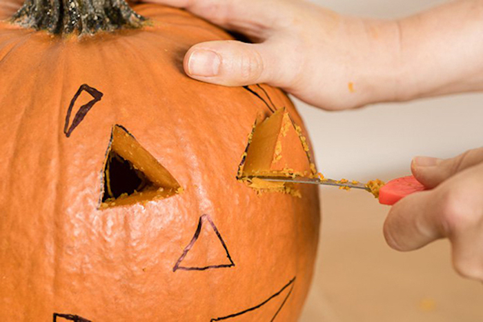 step by step, diy tutorial, scary pumpkin faces, cutting out shapes, into a pumpkin, with a knife