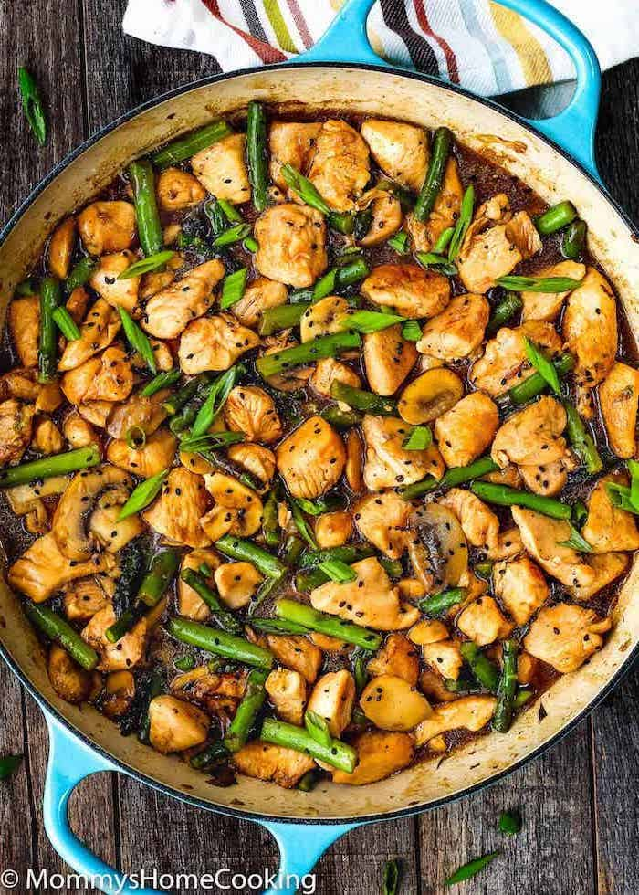 chicken and asparagus, cooked in a skillet, healthy meal prep recipes, wooden table
