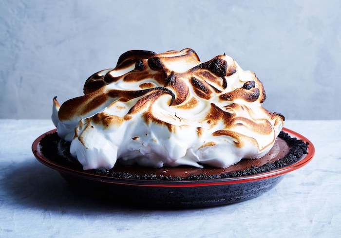 chocolate pie, toasted meringue on top, in a black tray, no bake recipes, white background