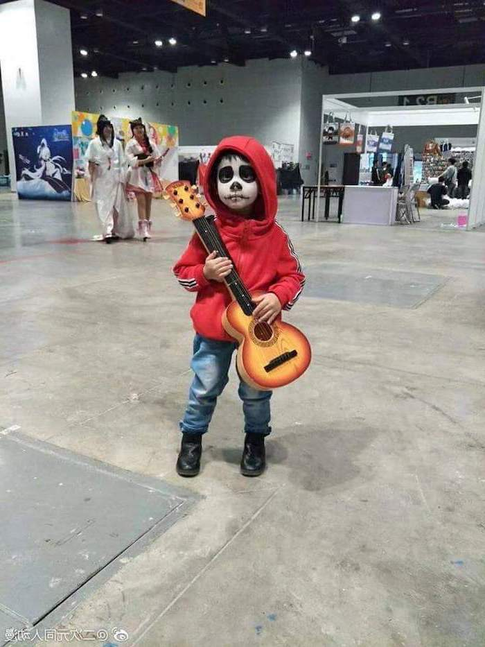 little boy, dressed as miguel rivera, holding a guitar, toddler boy costume, coco movie inspired, red hoodie