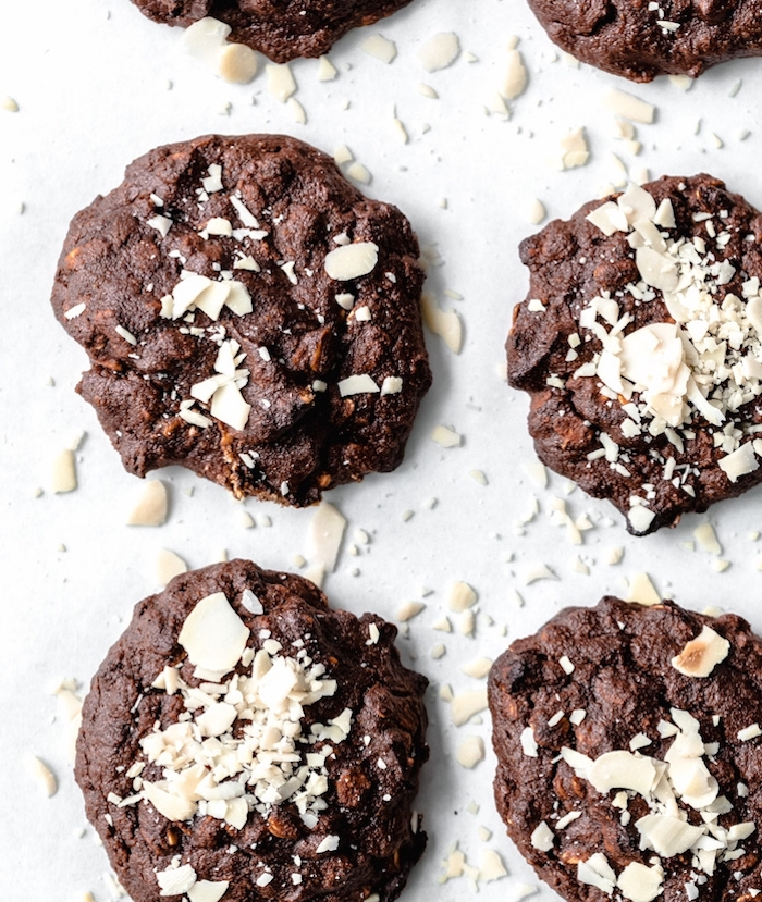 cocoa cookies, shaved almonds on top, easy chocolate chip cookies, arranged on white table