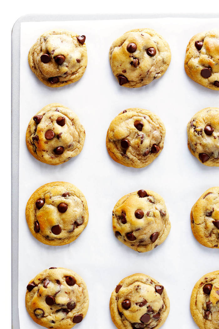 cookie dough, with chocolate chips, arranged on a white board, best chocolate chip cookies