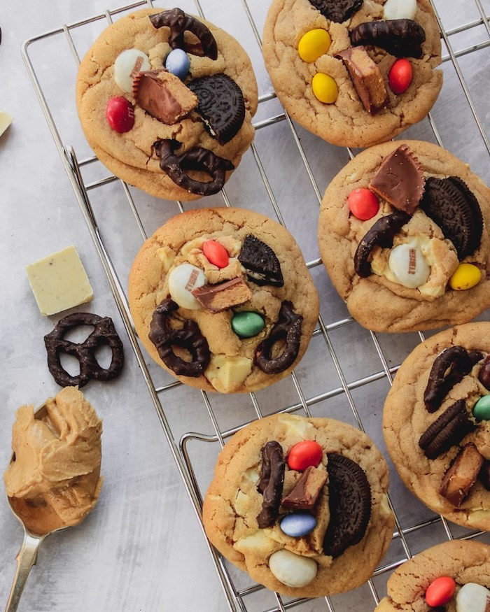 cookies with peanut butter, oreos and pretzels, reeses pieces, soft chocolate chip cookies, metal rail
