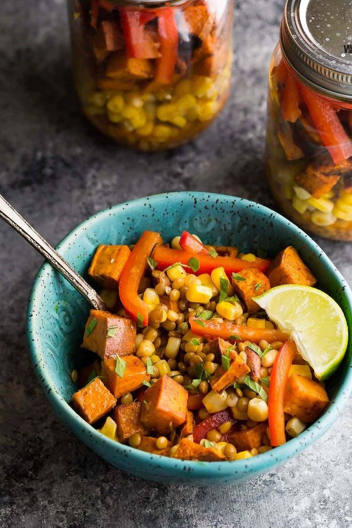lentils and corn, sweet potato salad, inside a blue bowl, how to meal prep, lime slice on the side, granite countertop