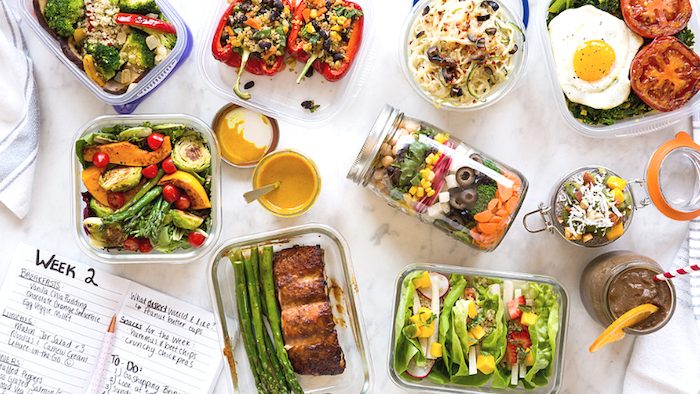 easy healthy lunch ideas, weekly planner, different meals, in glass containers, mason jars, marble countertop