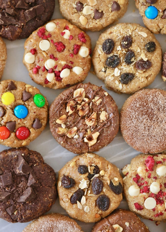 different cookies, with raisins and nuts, candy and sprinkles, soft chocolate chip cookie recipe, arranged together