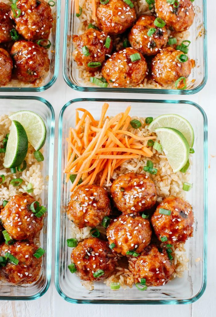 honey sriracha meatballs, meal prep for weight loss, rise and carrots, in a glass container, lime slices