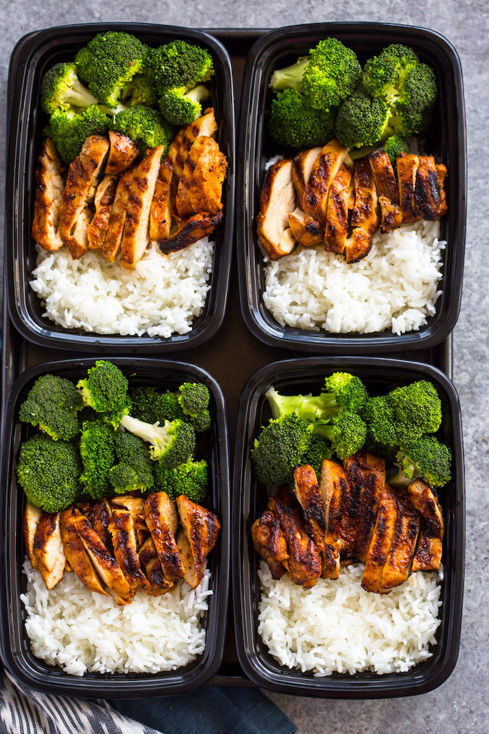 chicken fillet, broccoli and rice, healthy lunches for work, inside four black, plastic containers