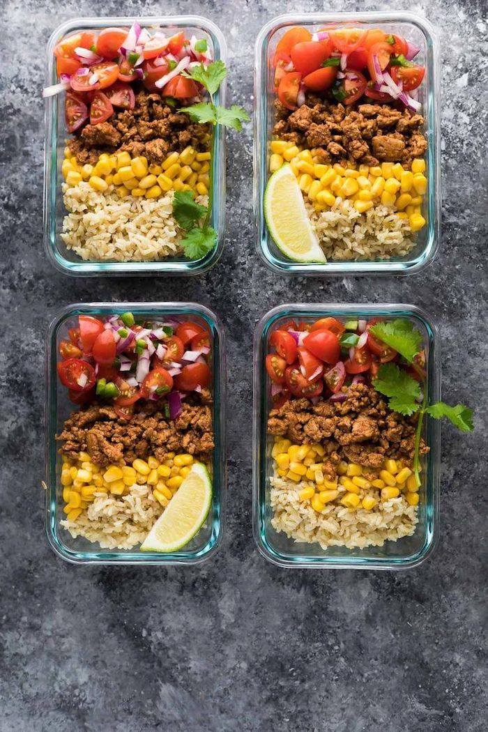 four glass containers, ground turkey, salsa and corn inside, lemon slice on the side, chicken meal prep