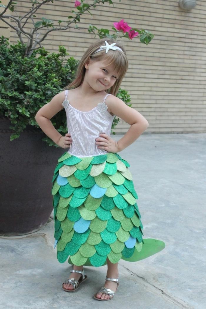 baby girl halloween costumes, little girl, dressed as a mermaid, with blonde hair, mermaid skirt, silver sandals