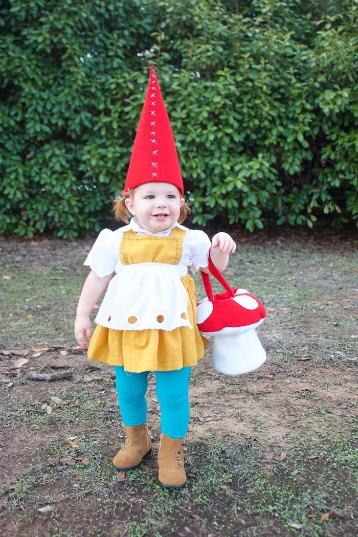 little girl, dressed as a garden gnome, large red cone hat, baby girl halloween costumes, blue tights, mushroom bag