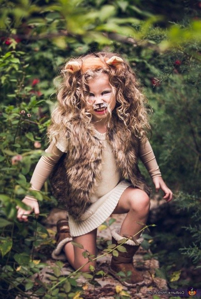 girl dressed as a lion, baby girl halloween costumes, blonde curly hair, for a mane, furry vest