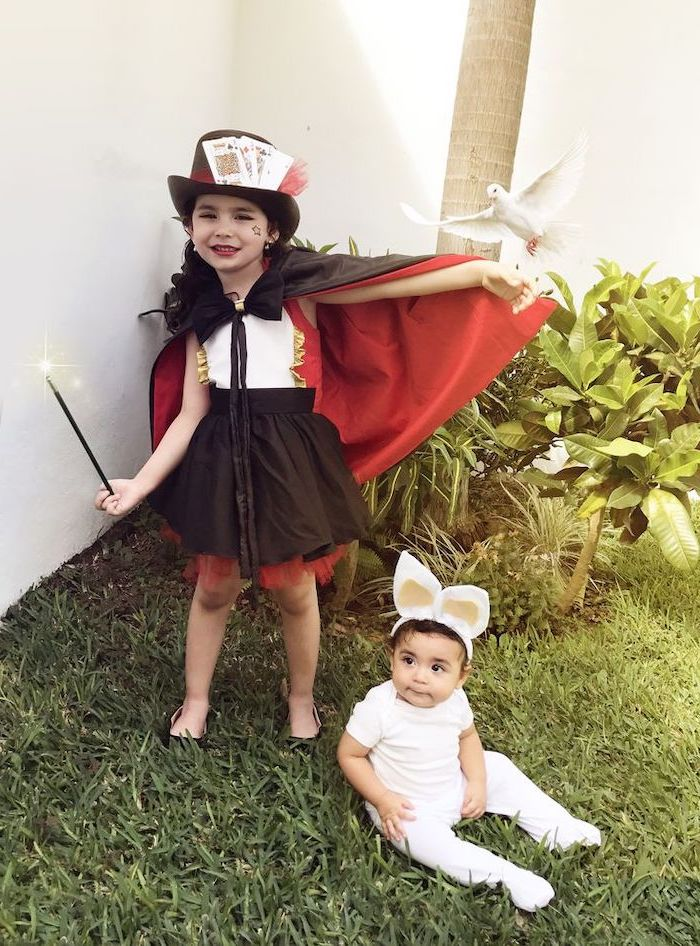 girl dressed as a magician, baby dressed as a rabbit, toddler girl costume, black and red cape, magic wand