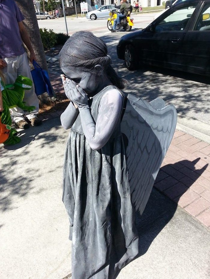 little girl, dressed as weeping angel, covered in silver paint, baby girl halloween costumes, carton wings