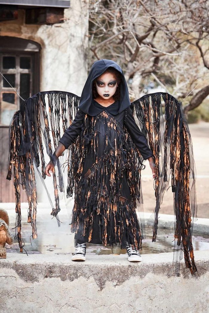 halloween costumes for kids, little girl, dressed as an angel of death, wearing black shoes, face makeup