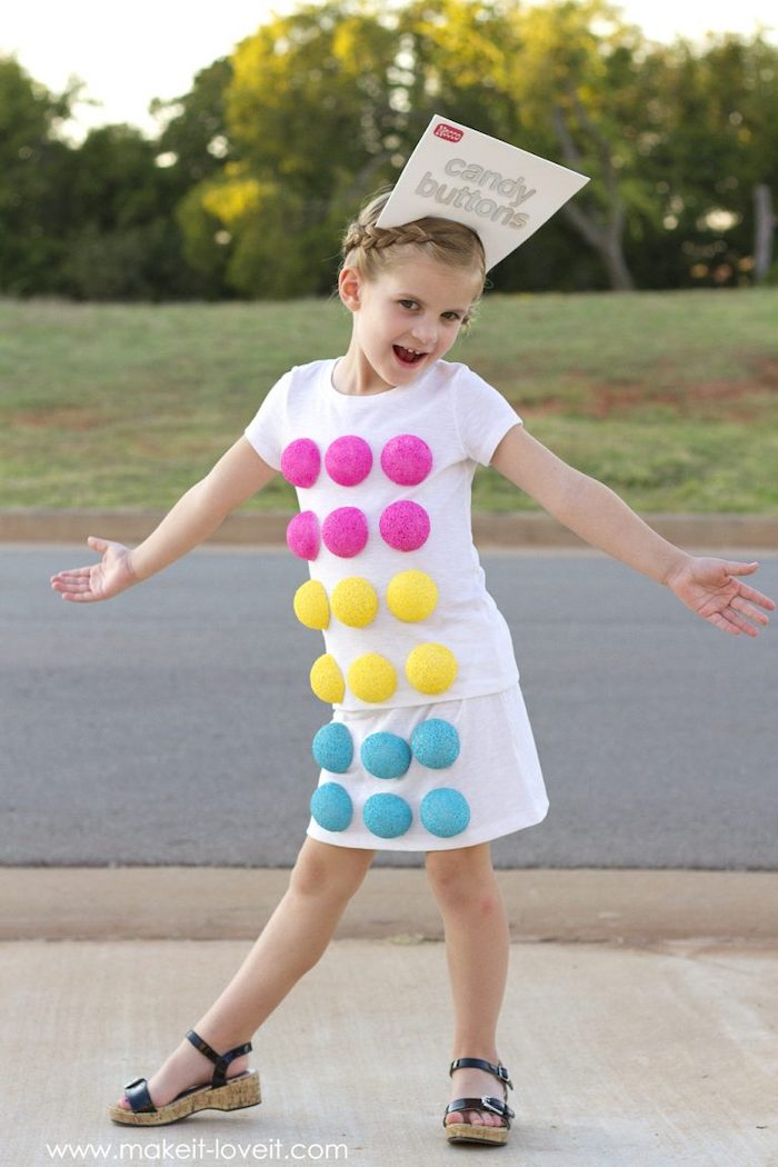 girl dressed as candy buttons, best halloween costumes, step by step, diy tutorial, white shirt and skirt