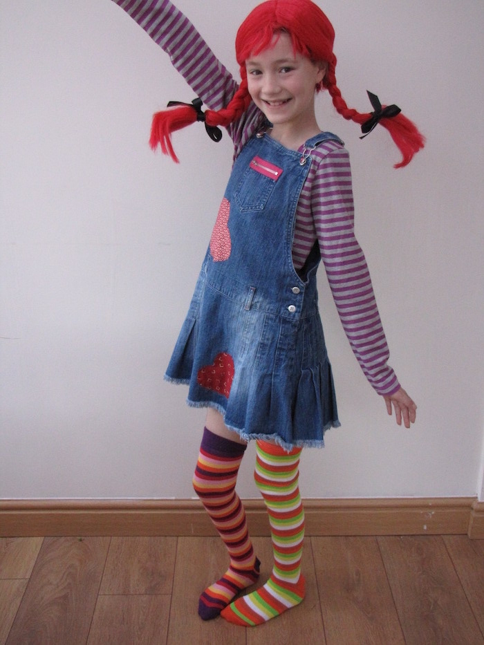 girl dressed as pippi longstocking, red wig, braided in two braids, different socks, baby girl halloween costumes