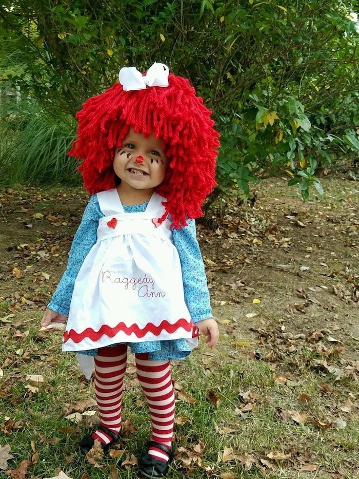 little girl, dressed as raggedy ann, wearing a red wig, face makeup, halloween costumes for kids