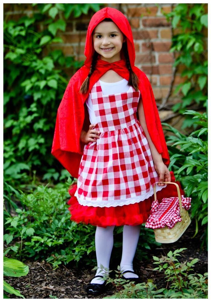 girl dressed as red riding hood, cool halloween costumes, red cape, lunch basket, braided hair