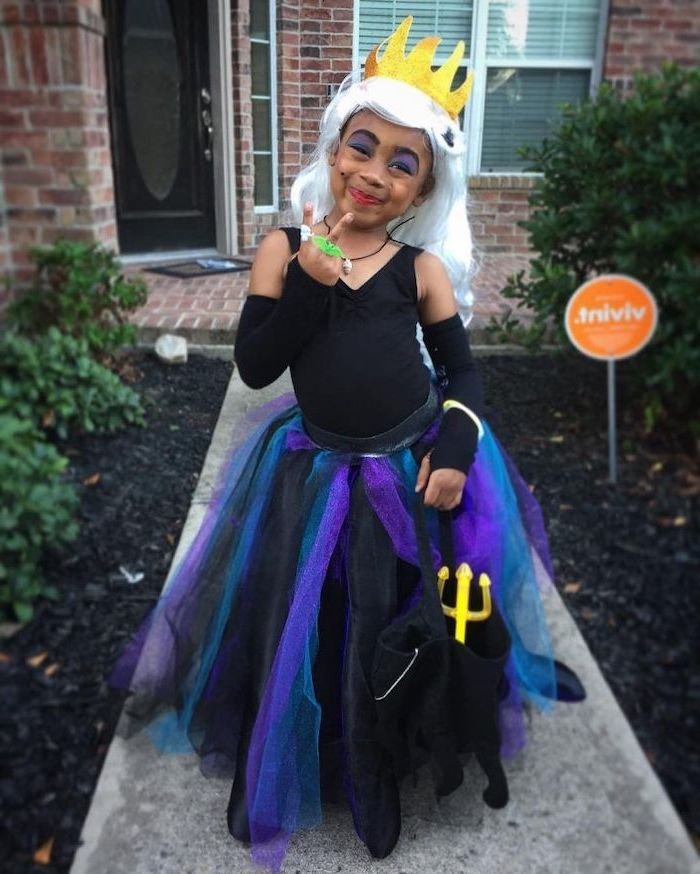girl dressed as ursula, ariel inspired, cute halloween costumes for girls, black purple and blue, tulle skirt