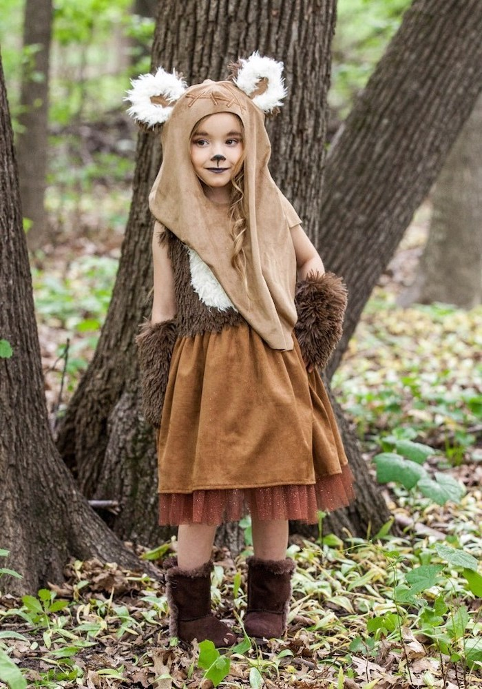 girl dresses as wicket, star wars inspired, ewok character, cool halloween costumes, in the middle of the forrest