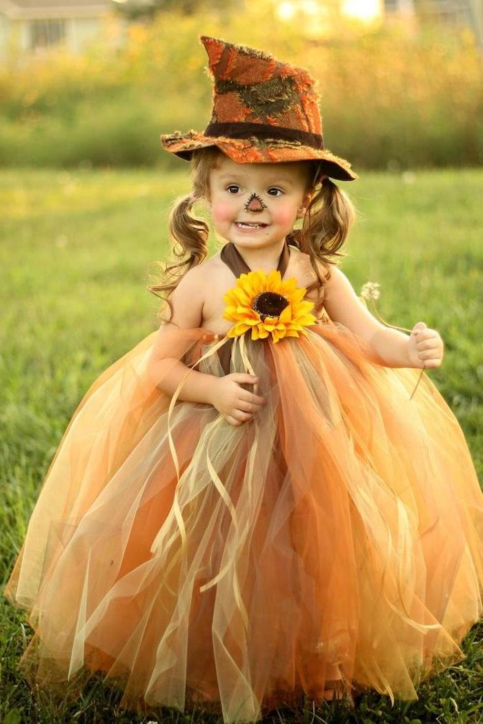 halloween costume ideas for girls, little girl, with blonde hair, in ponytails, dressed as a scarecrow, tulle skirt