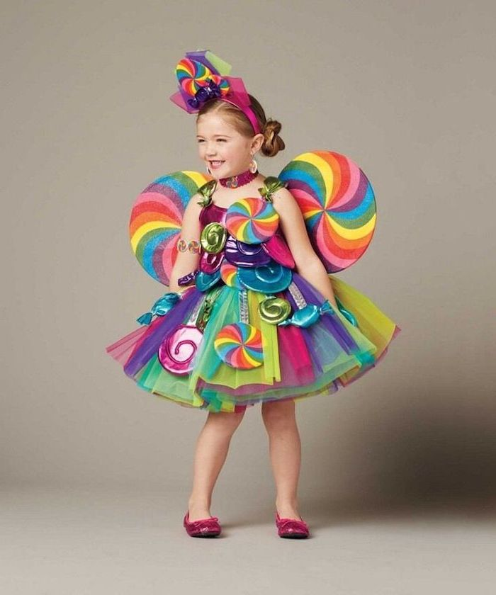 girl with blonde hair, dressed as candy, tulle skirt, halloween costume ideas for girls, colorful costume