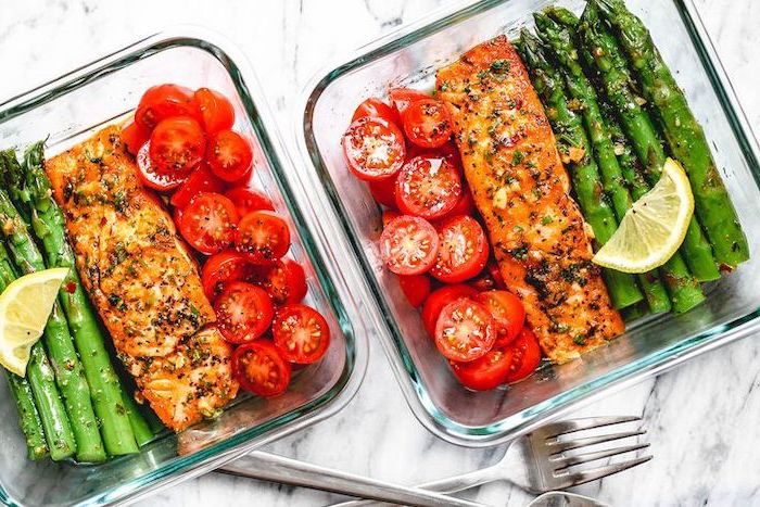 salmon and asparagus, cherry tomatoes, in a glass container, healthy meal prep ideas for weight loss, lemon slice