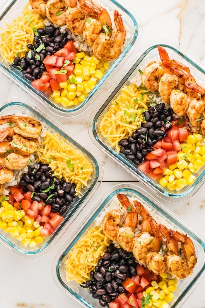 glass containers, filled with corn and cheese, shrimp and tomatoes, black beans, healthy meal prep ideas for weight loss