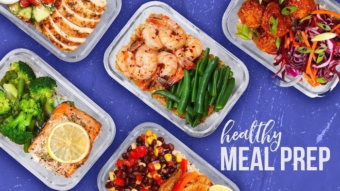 healthy meal prep, healthy meal prep ideas for weight loss, plastic containers, with different meals, purple background