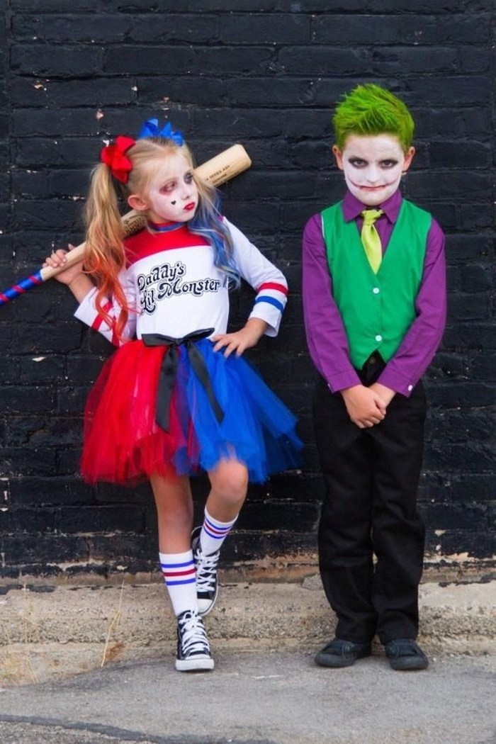 boy and girl, dressed as harley quinn and the joker, halloween costume ideas, red and blue tulle skirt, green hair