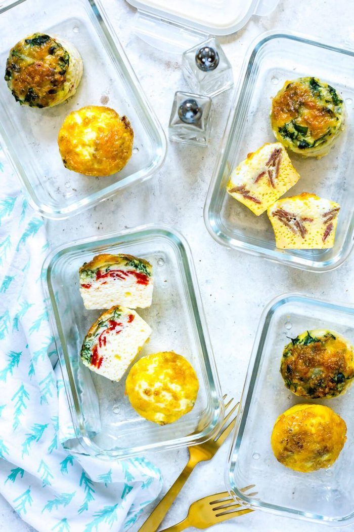 four glass containers, egg bites inside, meal prep, salt and pepper, brass forks
