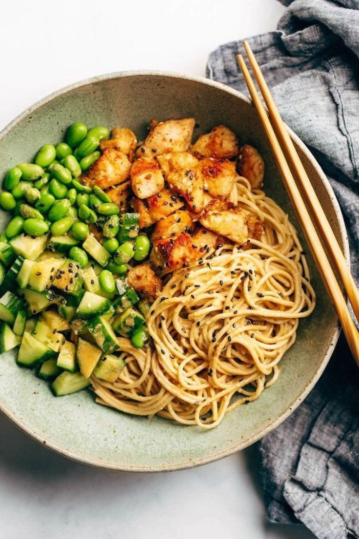 sesame noodles, beans and cucumbers, healthy meal prep ideas, chicken fillet, in a plate, chop sticks