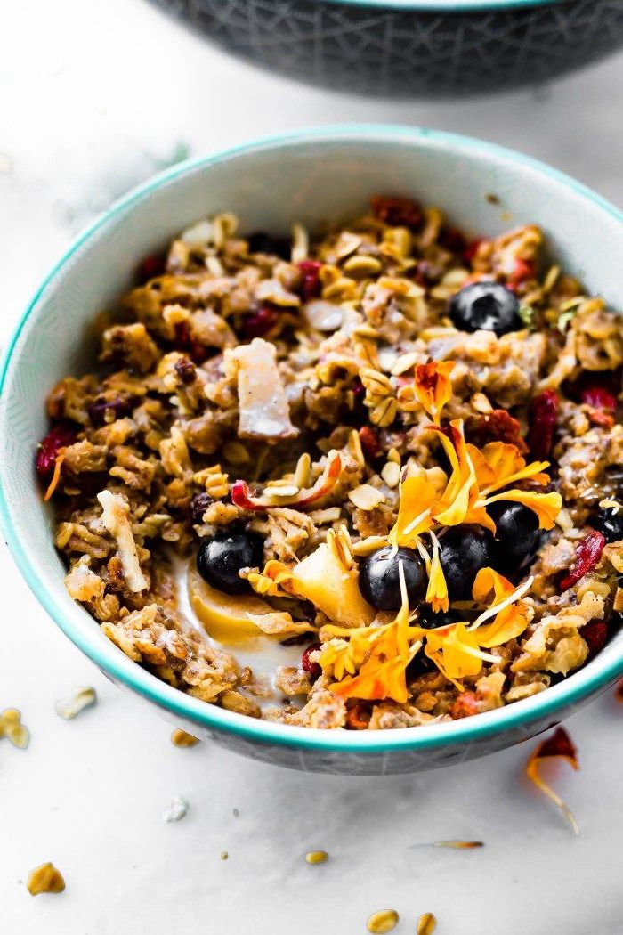 oatmeal and milk, blueberries and apples, inside a blue bowl, meal prep recipes, marble countertop