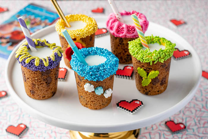 cookie dough cups, milk inside, sprinkles on top, chewy chocolate chip cookies recipes, paper straws, white plate