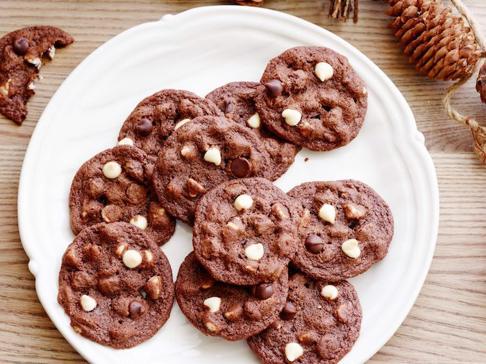 cocoa cookies, with white chocolate chips, homemade chocolate chip cookies, white plate, wooden table