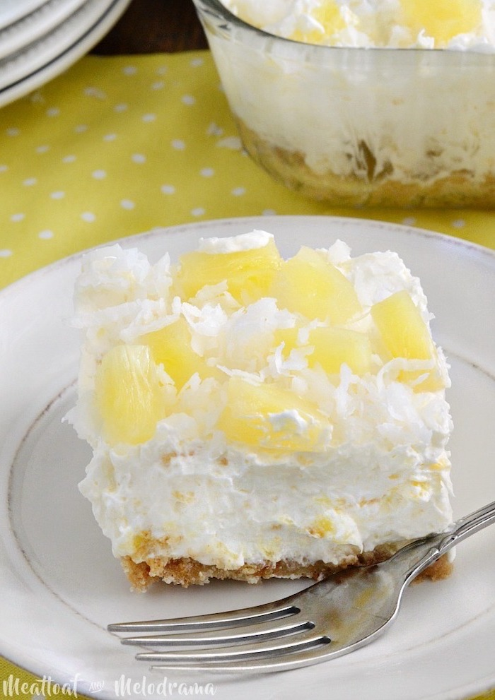 pineapple cheesecake, simple dessert recipes, pineapple slices, coconut flakes on top, white plate