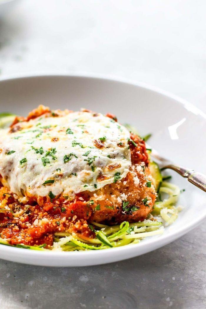 zucchini noodles recipe, chicken parmesan, tomato sauce, in a white plate, granite countertop