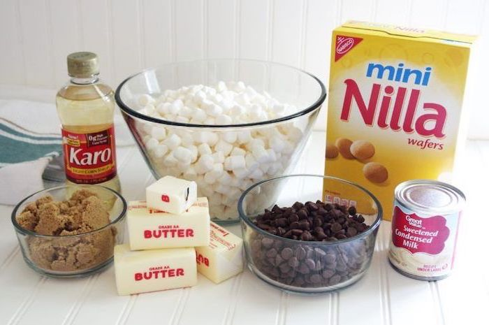 necessary ingredients, butter and sugar, wafers and chocolate chips, marshmallows in a glass bowl, quick and easy desserts