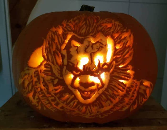 pennywise the dancing clown, it movie inspired, cute pumpkin carvings, lit by candles
