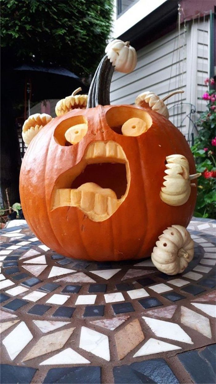large carved pumpkin, attacked by small carved pumpkins, pumpkin carving faces, tiled floor, pumpkin inside pumpkin carving patterns