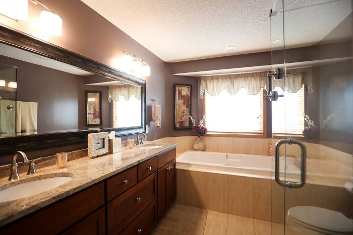 large bath, shower cabin, large wooden vanity, large mirror, tips for your bathroom remodel