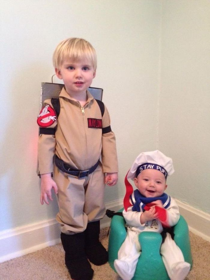 boy dressed as a character from ghostbusters, baby dressed as marshmallow man, superhero costumes for kids