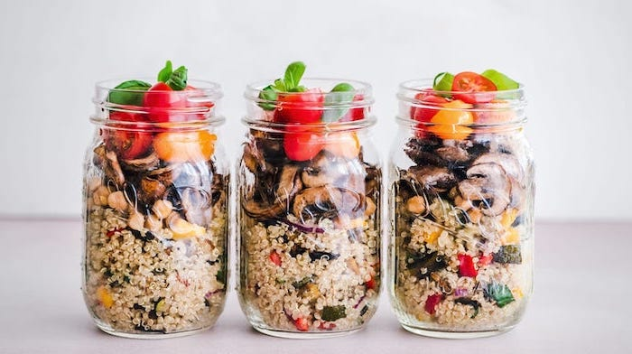 three mason jars, easy lunches for work, cherry tomatoes, quinoa salad, chopped mushrooms