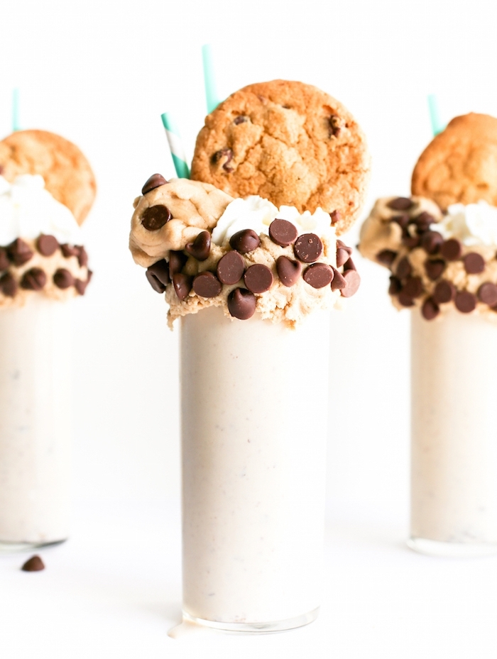 vanilla milkshake, cookie dough on top, cookies on top, tasty chocolate chip cookie, paper straws