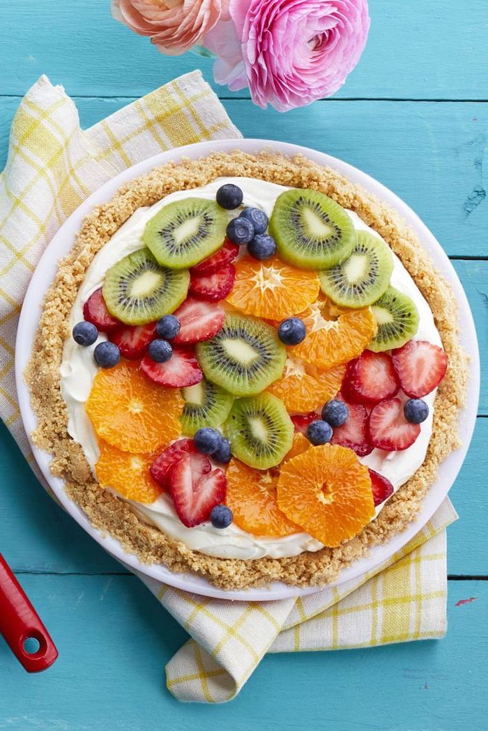 fruity tart, slices of different fruits on top, kiwi and orange, strawberries and raspberries, easy dessert recipes