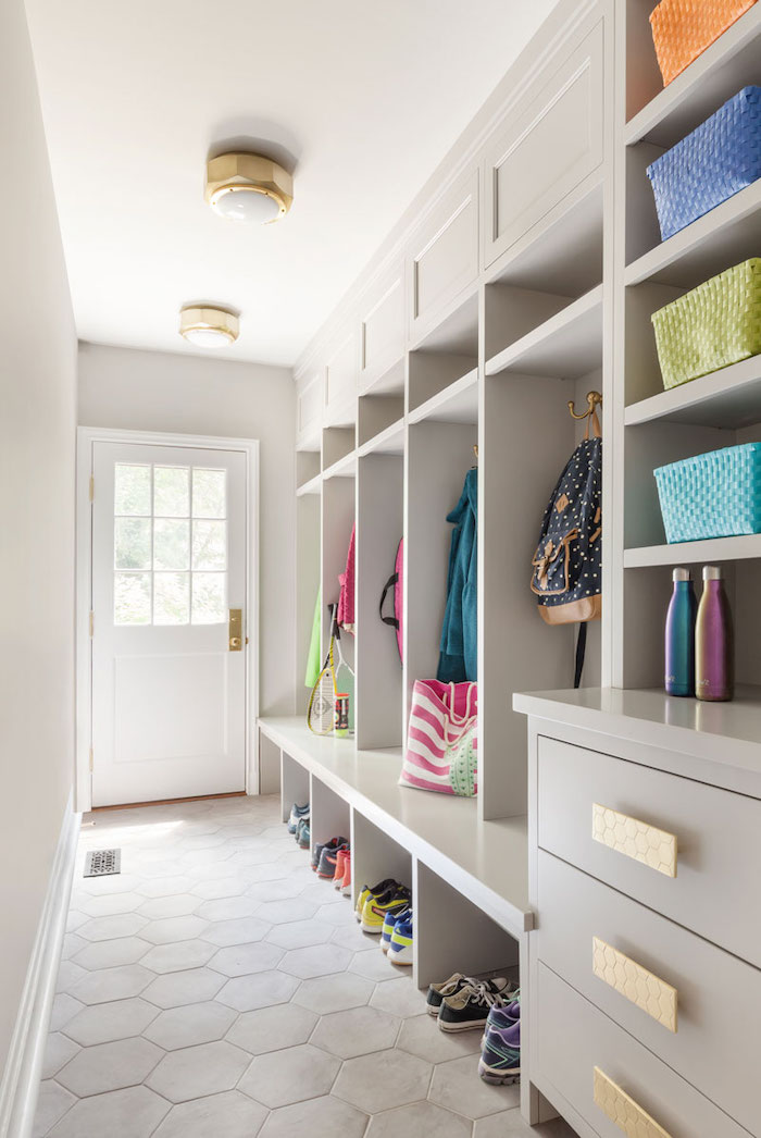 white wooden shelves and drawers, hanging jackets and backpacks, pairs of shoes, update your entrance hall