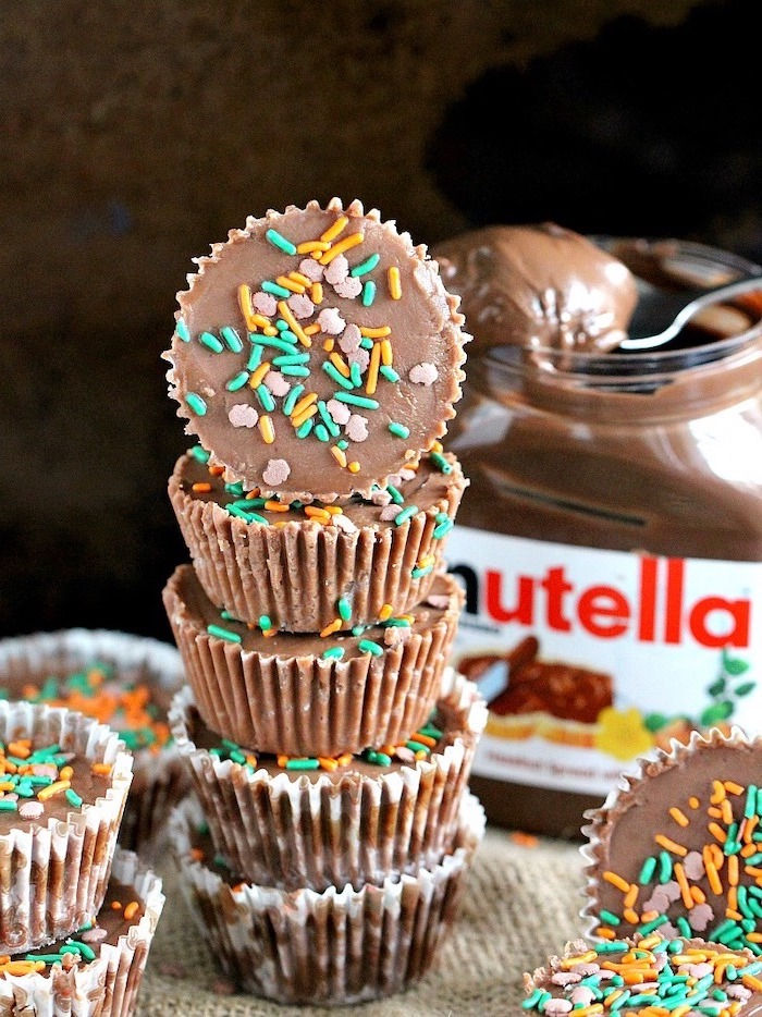 nutella pieces, covered in sprinkles, simple dessert recipes, nutella jar in the background