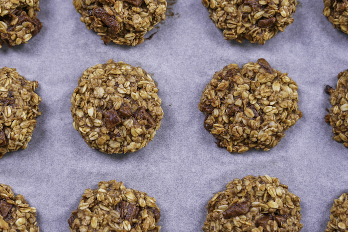 oatmeal cookies, with raisins, chocolate chip cookie recipe, arranged on a white baking paper